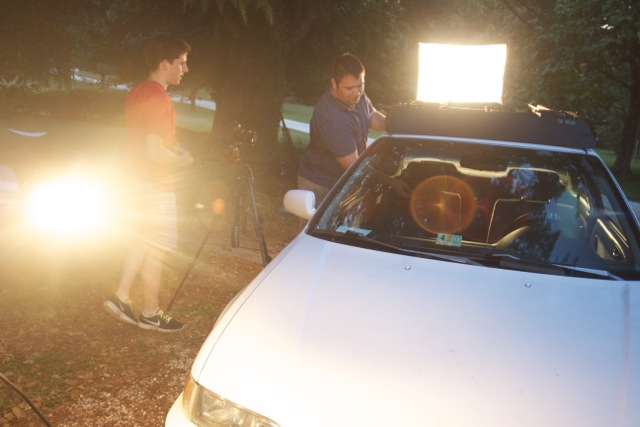 Setting up the lights for the last scene from the first day of shooting.