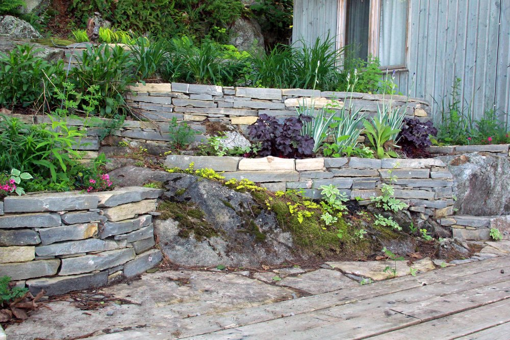Riverview landscape dry lay naturalized terrace planters.jpg