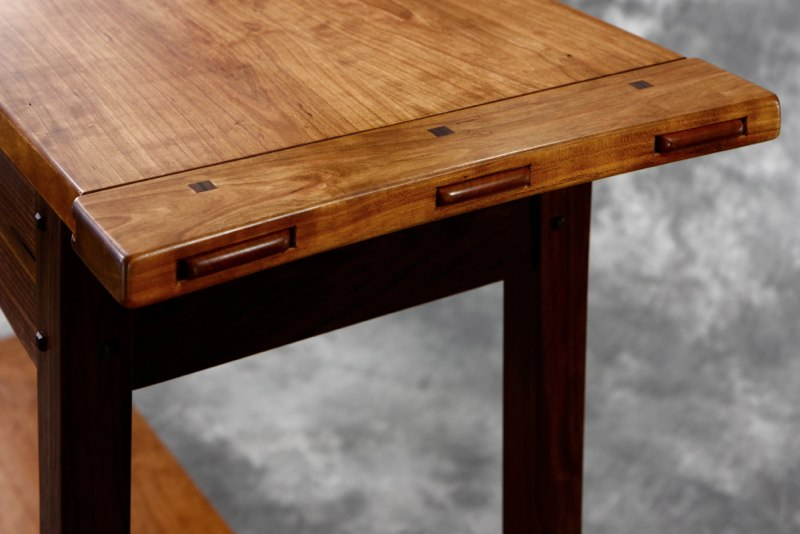 Greene & Greene inspired breadboard end on  Walnut & Cherry Hall Table