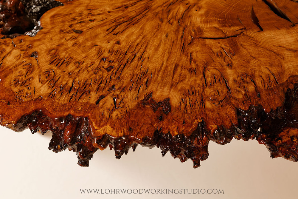 Live Edge Detail of Brown Oak Burl Table