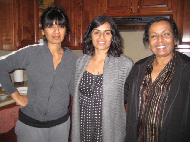 Sonia, Meghana, & their mother, Sandhya, hanging out in the kitchen, where you can usually find them