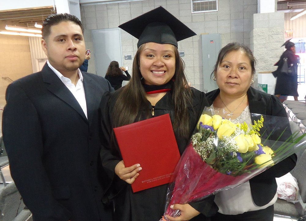 Sonia at her college graduation this June - with her mother and brother.