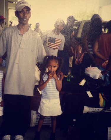 Shameeza as a child with her father in Guyana.