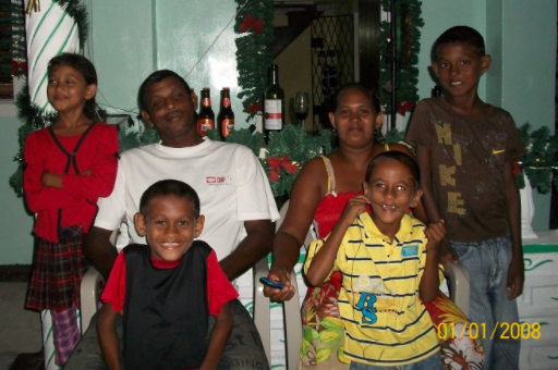 The twins' mother with their half-siblings in Guyana