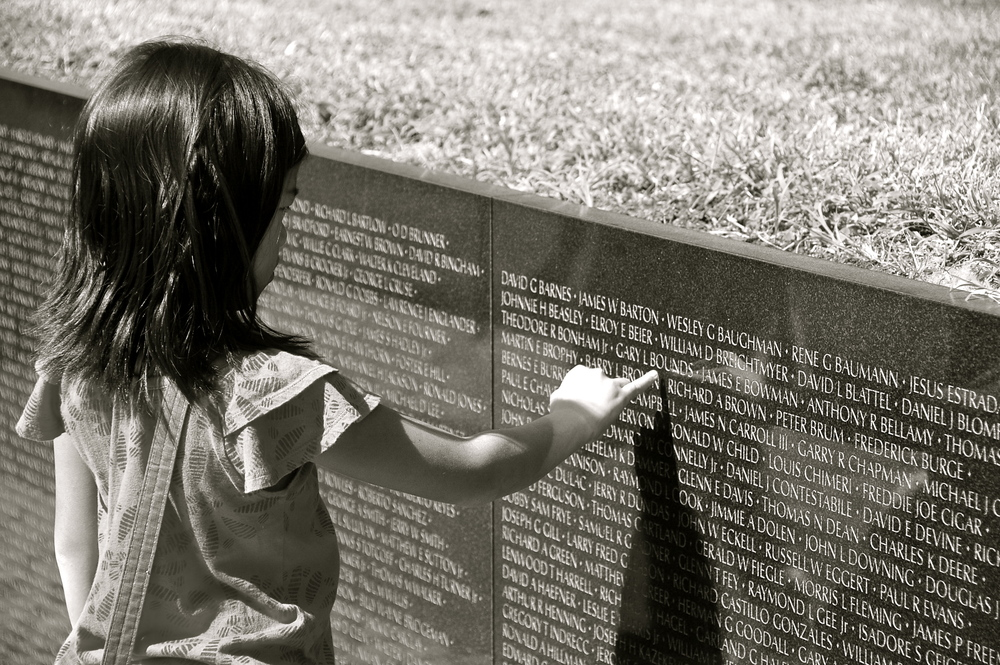 Young girl at Vietnam Memorial in Washington, D.C.