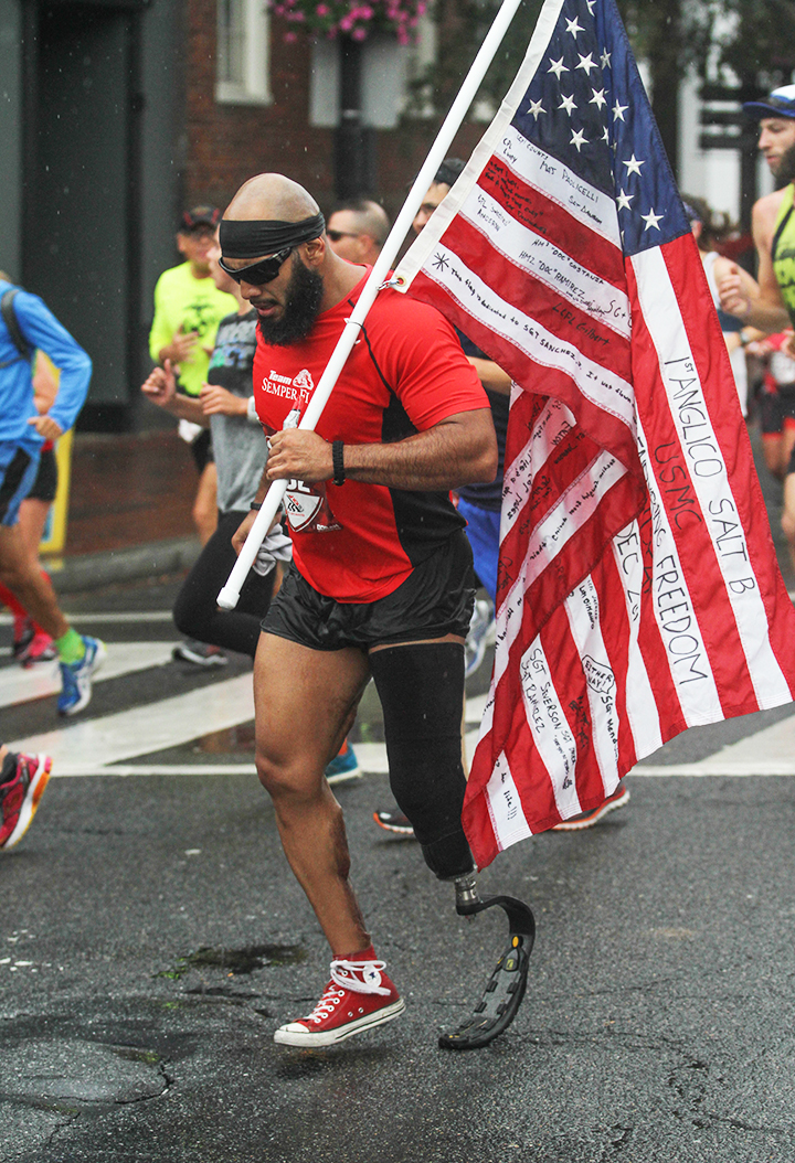 Veteran carrying flag in Washington, D.C half marathon