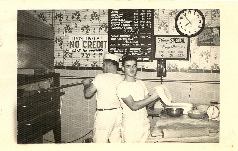 A shot of Tony Ciannamea (left) and an employee preparing pies during the early days.