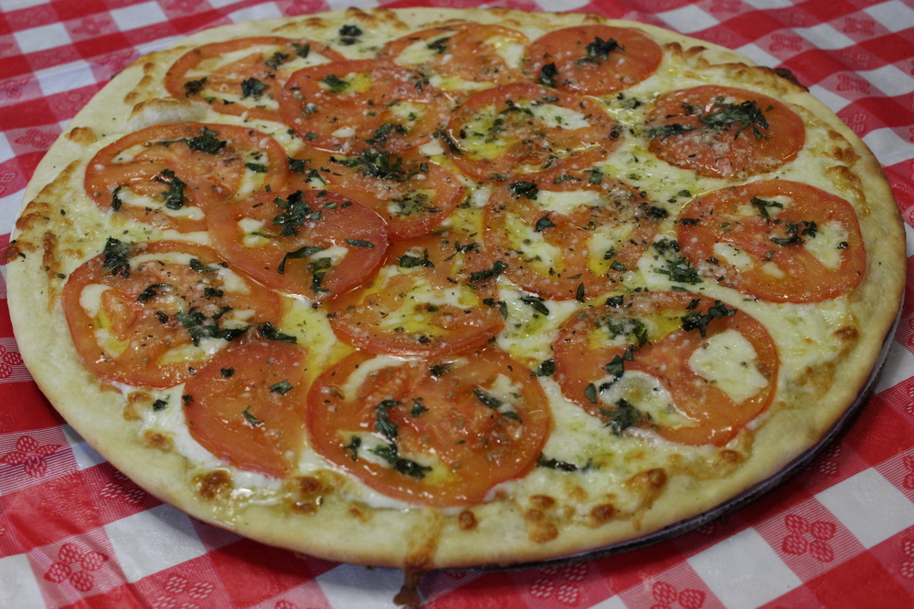 Pizza Margherita: X-Thin Crust with Mozzarella, topped with fresh tomatoes and basil  $ 4.80 PERSONAL /  $ 12.95 SMALL /  $ 15.10 MEDIUM /  $ 17.25 LARGE /  $ 19.50 X-LARGE