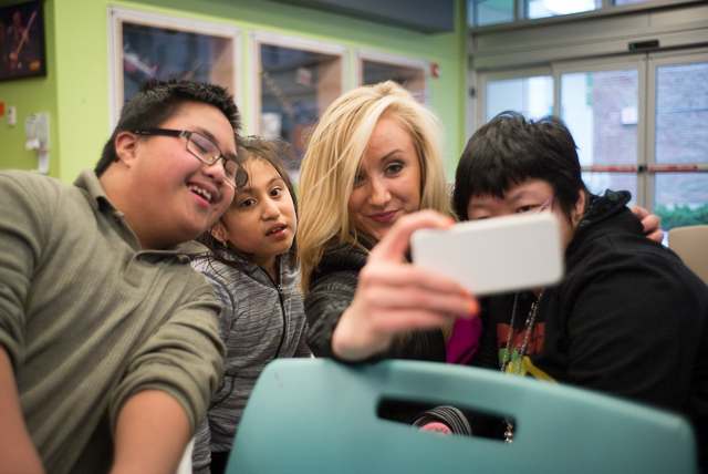 Olympic gymnast Nastia Liukin takes a photo with patients Lance, Stephanie and Annie during her visit at St. Mary's hospital in Bayside Friday.