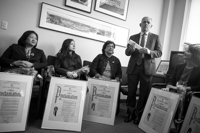 Council member Jimmy Van Bramer, standing, honored six women in his district office for their community efforts in celebration of women's history month. Pictured are Eve Guillergan, Monica Gutierrez, Lynn Lobell and Rachel Thieme. April 5th, 2014.