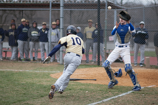 Xaverian second baseman Joseph Vitacco (10) attempts to run for home plate as Molloy catcher Logan Conroy (25) makes the catch.