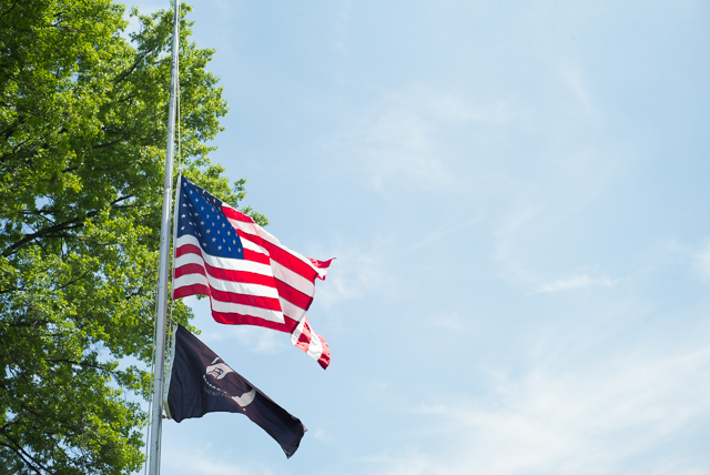 The flag at the Whitestone Veterans Memorial hangs at half mast in the memory of fallen soldiers.