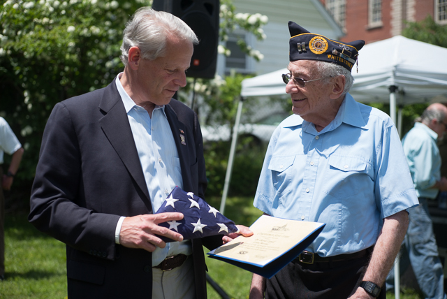 U.S. Rep Steve Israel present Dr. David Copell, the Grand Marshall of the Whitestone Memorial Day Parade, with a flag and certificate of recognition.