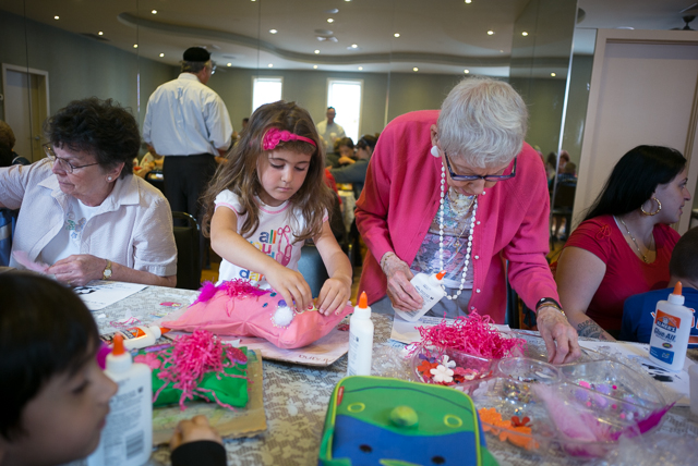 Ariana Hot, 4, a preschooler from P.S. 87 works with Muriel Vuccino during an art event at the Middle Village Adult Center which paired preschoolers and seniors for an afternoon.
