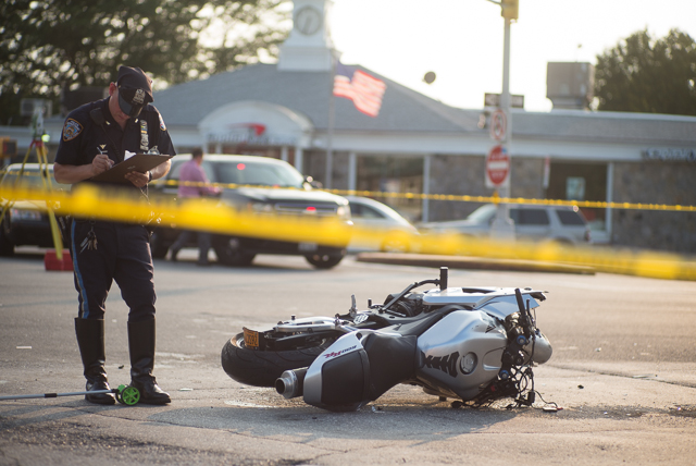 The NYPD's Collision Investigation Squad examines the scene of a motorcycle crash at the intersection of Francis Lewis Blvd. and Willets Point Blvd.