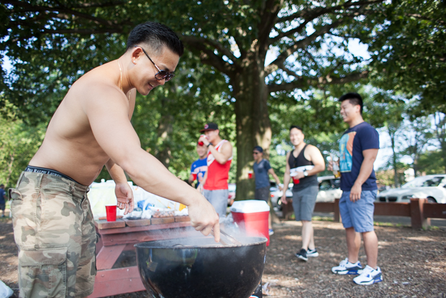 Bayside resident Yea Lee, a banker, works the grill during a barbecue with friends at Alley Pond celebrating Labor Day.