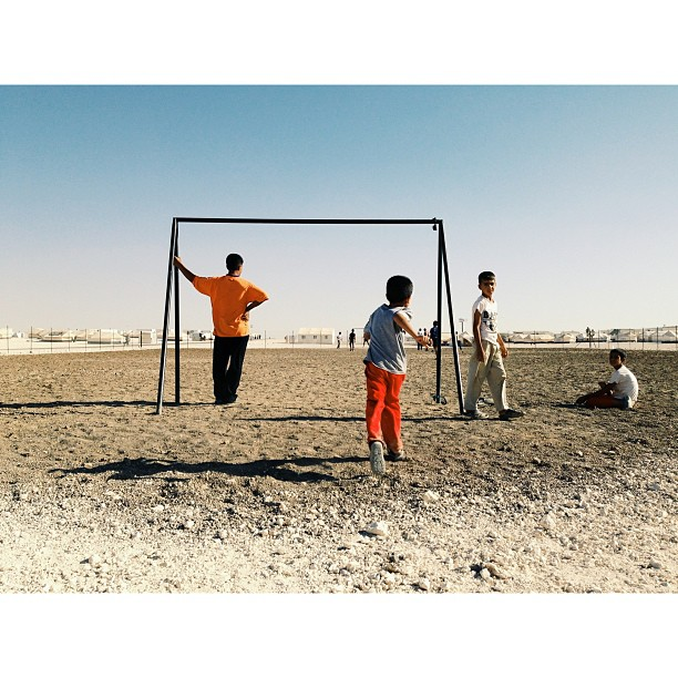"""Kids play soccer in the Zaatari camp. With the massive amount of children in the camp and the large family sizes, children and teenagers are one of the largest issues in the camp regarding crime and violence."" (at Zaatari Refugee Camp)"