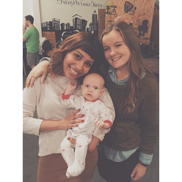 Two of our wonderful Children's Ministry volunteers loving on one of our little ones.