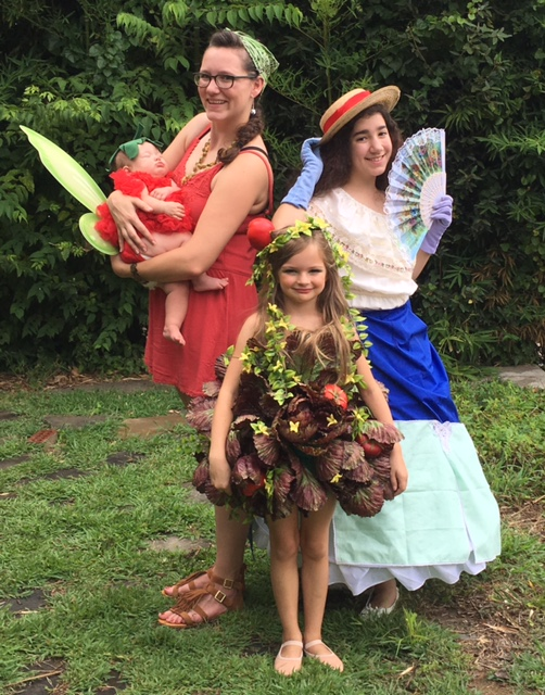 Tomato Fairy and Elf Contests: Sponsored by Fairy Tales Bookstore  Left to Right: Magnolia Crist with mom, Scarlett Riggs, and Liliana Gomez