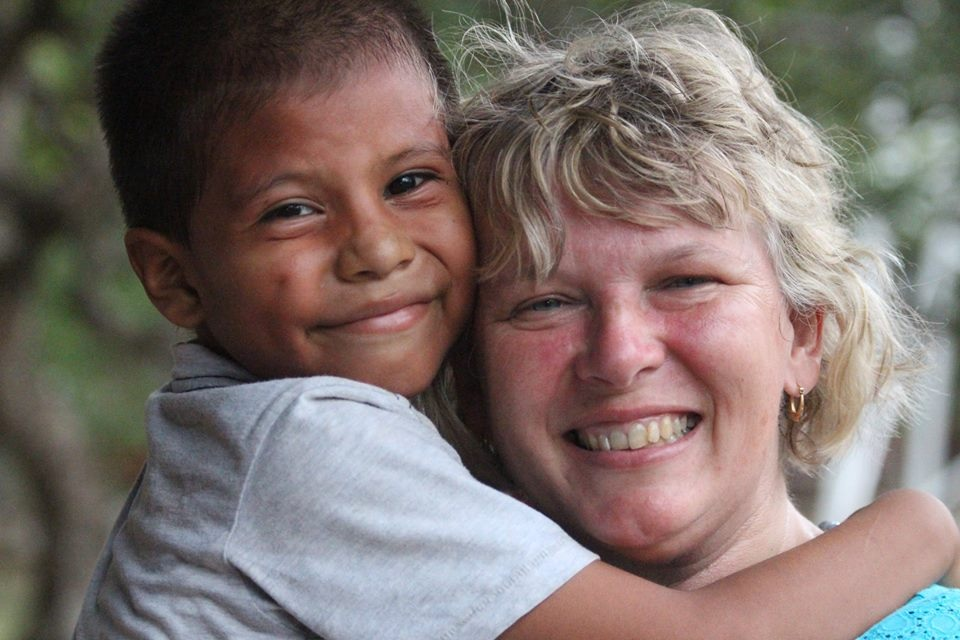 Anne Struthers sharing some love with a boy at the orphanage