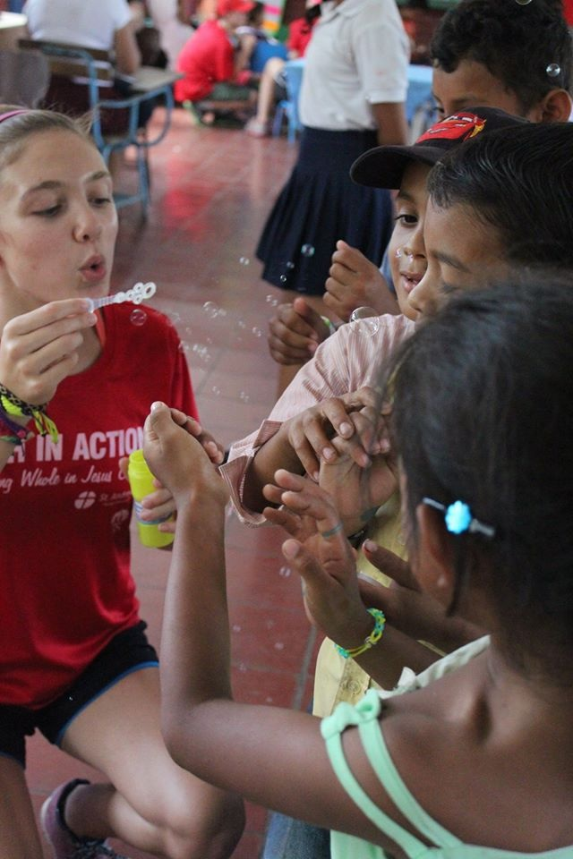 Bubbles are always a big hit! Sarah's bubbles delight these children.