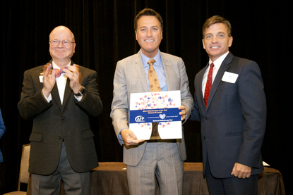 Michael W. Smith is presented with Philanthropist of the Year Award by the AFP