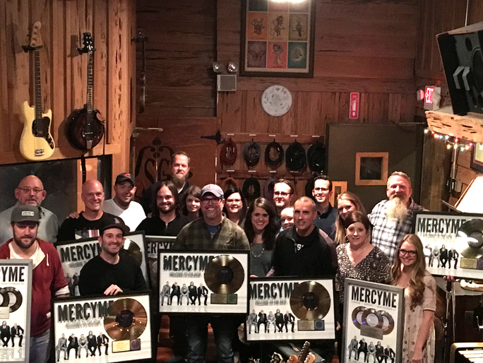 MercyMe pictured with the Brickhouse Entertainment and Fair Trade Services' teams.