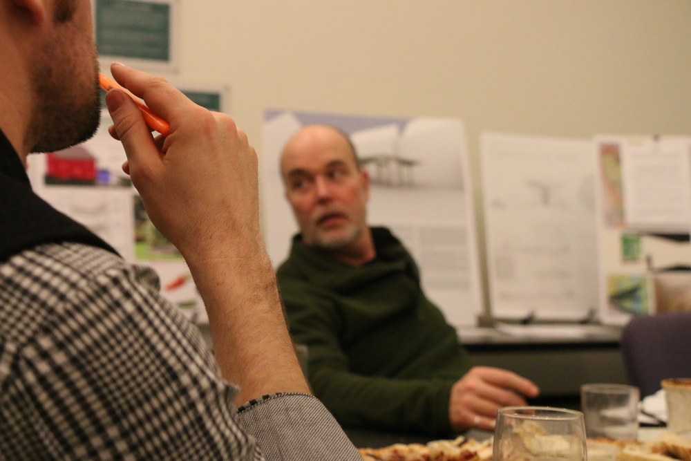 Rick Ames, juror for Living Place Design Competition, and Tyler Kobick discussing the projects.