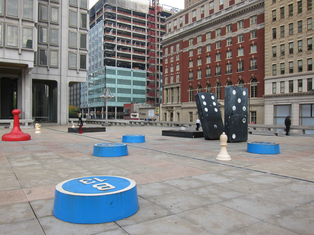 Philadelphia Municipal Plaza. For those who've wondered, the game-themed sculptures are part of a public art piece titled   Your Move  .
