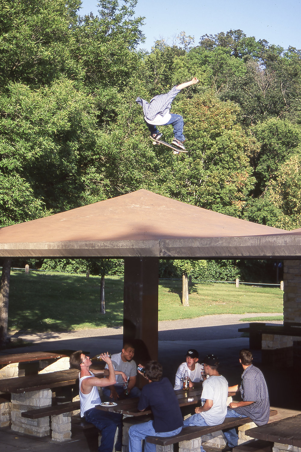 Elijah Collard ollies over a bunch of dudes chugging daytime 40s.