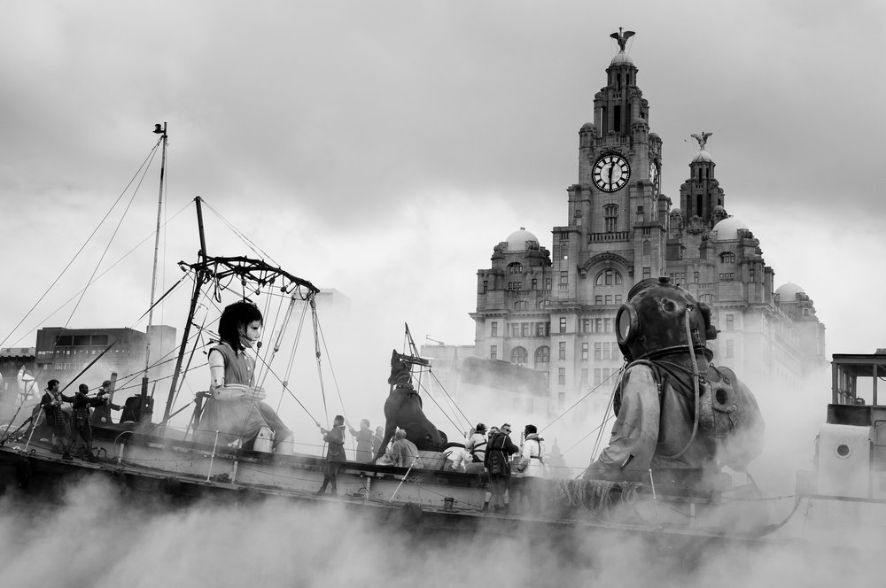 LIVERPOOL, UK, 22st April, 2012. The Sea Odyssey: A giant spectacular. A giant Uncle, his giant niece and her giant dog roam the city of Liverpool before leaving on a boat.