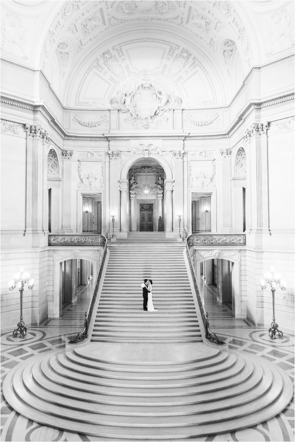 I met Aimee before photographing her wedding and we clicked instantly! I love when my clients and I share a similar vision and style because it makes everything fun and easy to plan! The day of their wedding, Aimee wore a beautiful wedding dress from BHLDN that suited her and San Francisco City Hall perfectly and I loved how elegant the low back looked on her. To top off the look, she wore a pair of stunning, sapphire, rhinestone encrusted Badgley Mischka's. Talk about a fabulous pair of shoes!  Their private, fourth floor ceremony was a perfect retreat from the rest of the bustling San Francisco City Hall. It allowed for an intimate hour with their friends, family, and the cutest little ring bearer, their son Nathan!  Congratulations Aimme and Michael! I am so happy to have met you and to be able to call you two new friends is an honor!