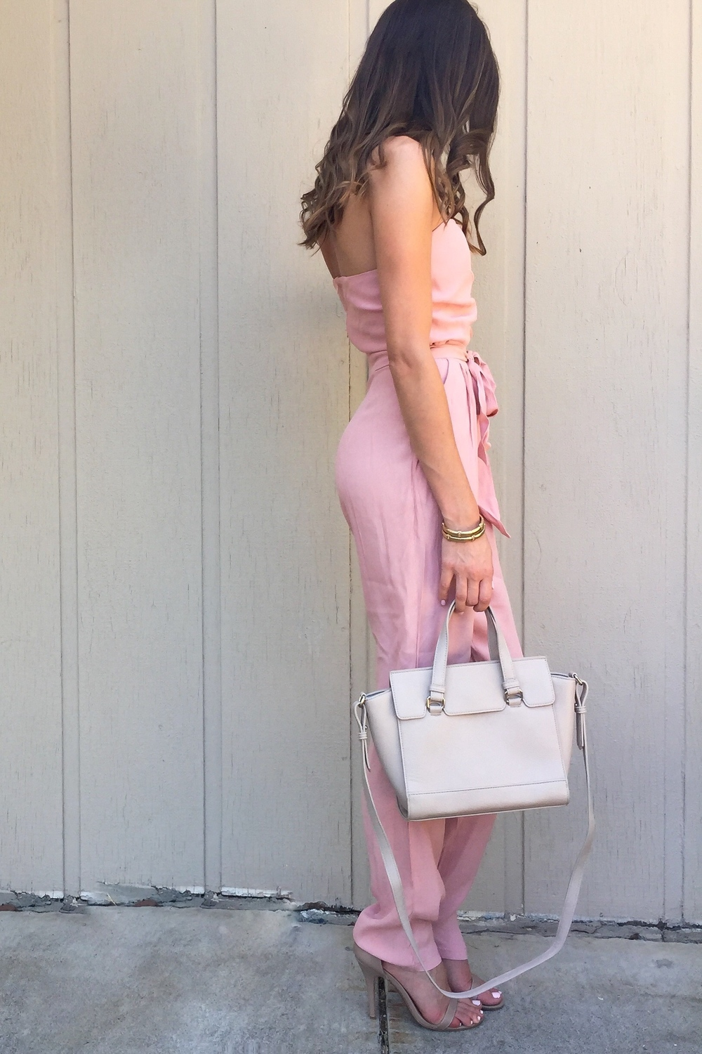 Shop the Look Below. Jumpsuit: c/o  Girls on Film . Bag:  Forever 21 . Shoes:  Steve Madden .