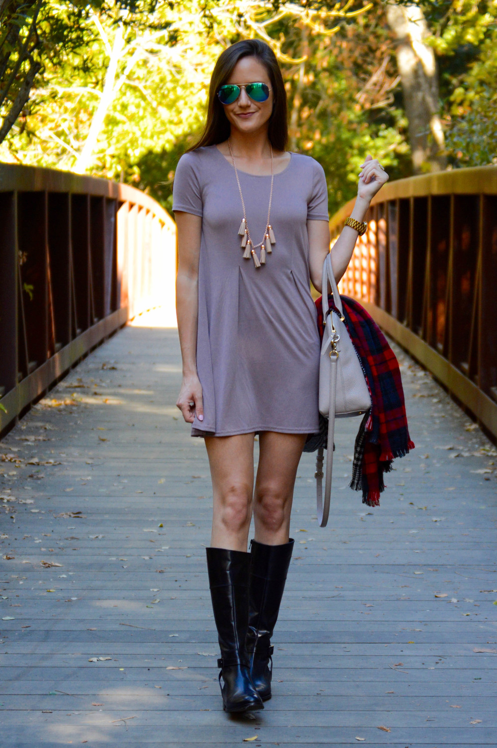 Shop the Look Below. Dress:  Urban Outfitters  (I own two colors and it's SO comfy1) Boots: c/o  Skinnycalf Boots . Bag:  Kate Spade . Scarf: I honestly can't remember, but similar  here  and  here . Necklace:  BaubleBar . Sunglasses: Off brand. Similar  here  and  here .