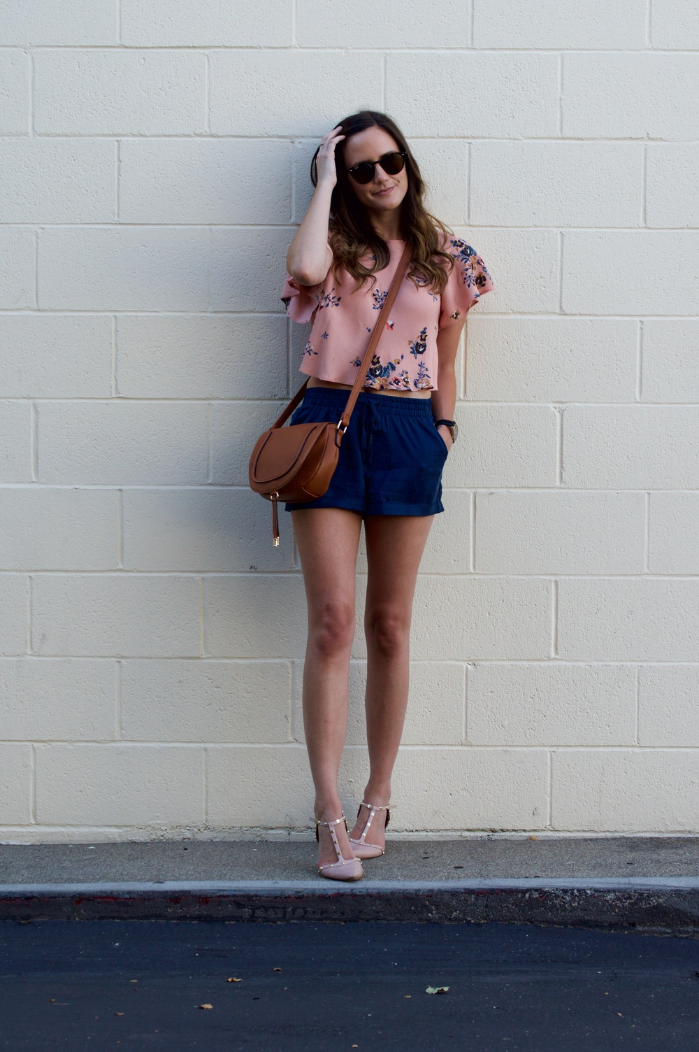 Shop the Look Below. Top: Urban Outfitters. Shorts: Nordstrom. Shoes: Nordstrom. Bag: ShoeDazzle. Sunglasses: Ray-Ban.