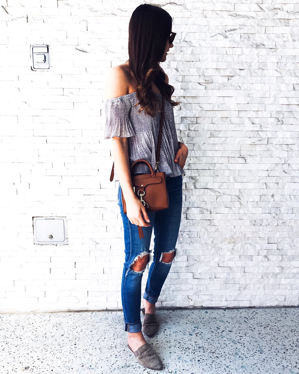 Levi's distressed skinny jeans and off the shoulder top