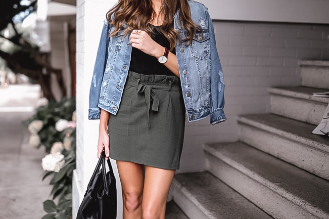 Olive miniskirt and distressed denim jacket