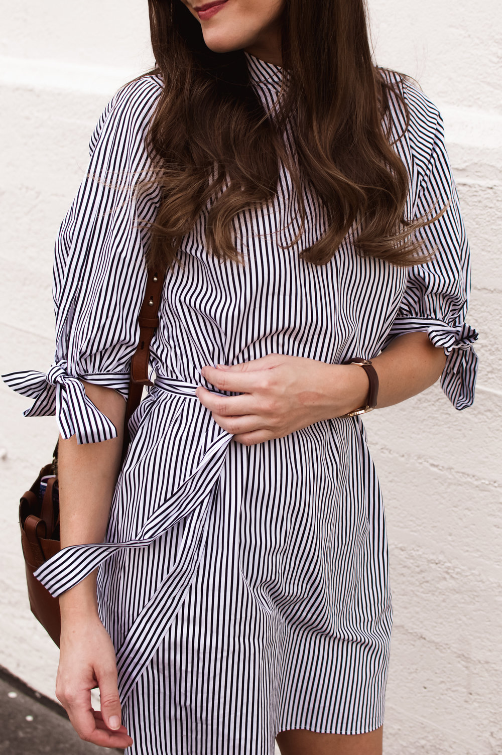 striped dress and brown crossbody