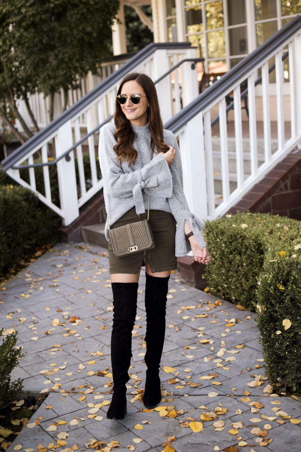 Shop the Look Below.  J.O.A Sweater  c/o Amazon|  Free People Skirt  |  Steve Madden Boots  | Rebecca Minkoff Bag—almost exact one  here  |  Ray-Ban Sunglasses