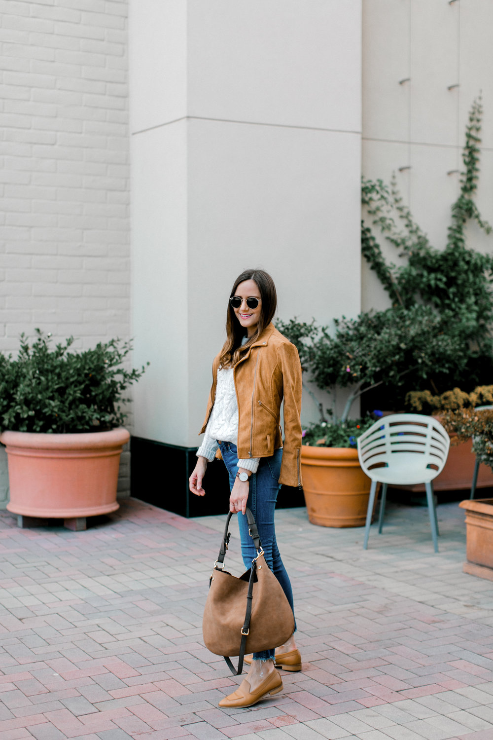 Shop the Look Below.  Topshop Sweater  |  Madewell Jeans  |  Everlane Loafers  | Shopbop Jacket—see similar below.  Sole Society bag  c\o |  Ray-Ban Sunglasses