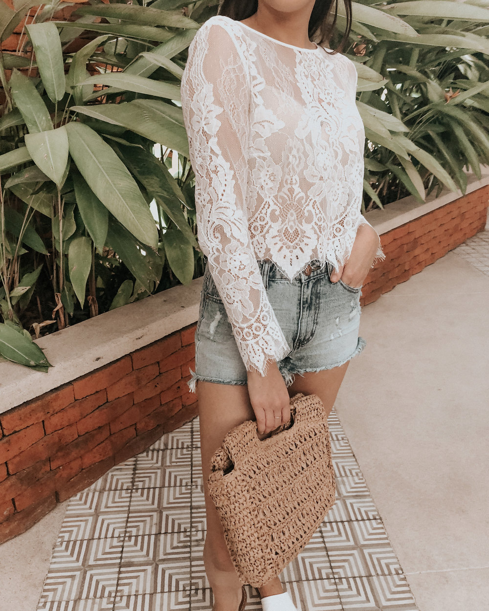 white lace top and cutoff shorts