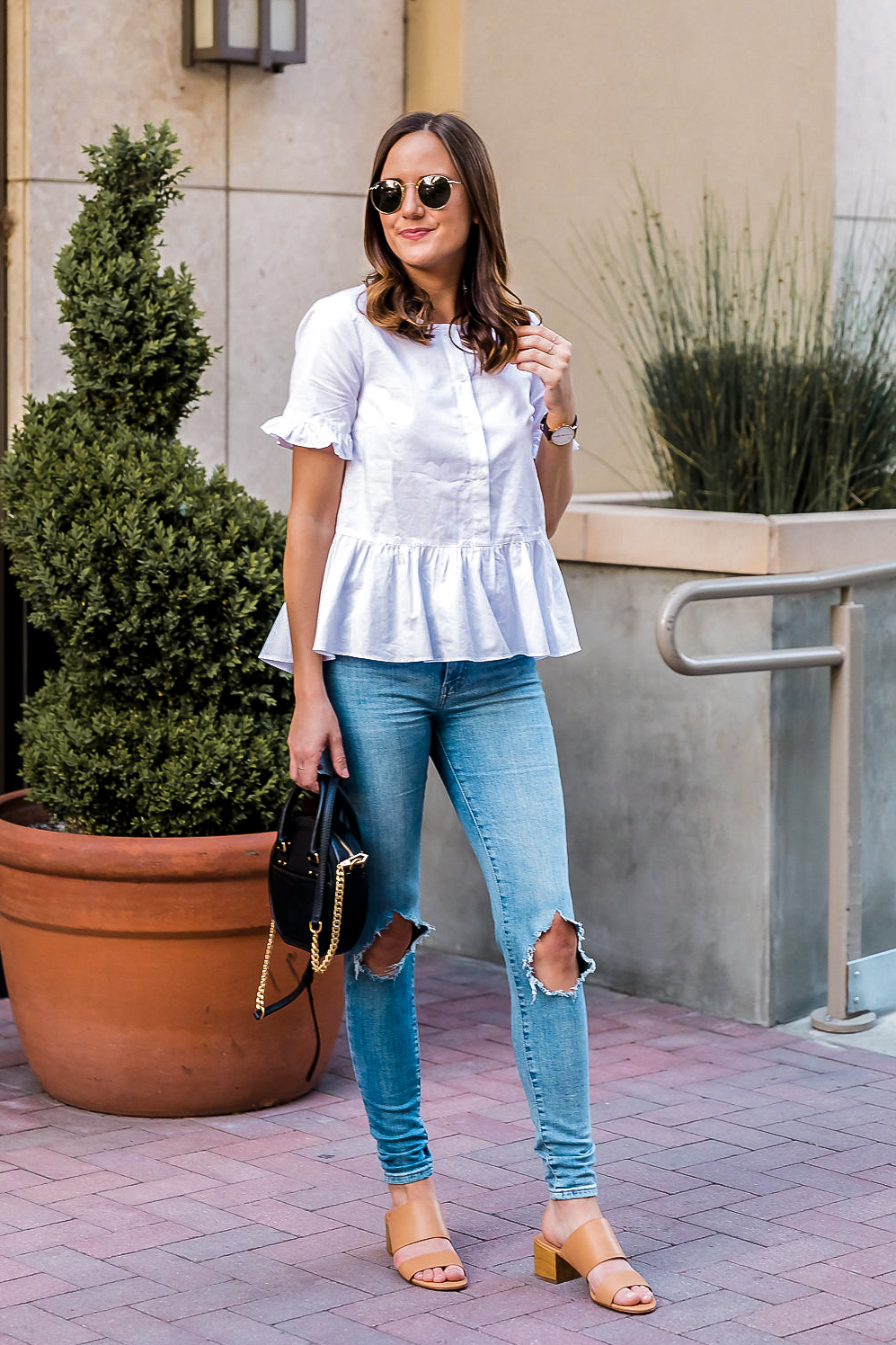 Shop the Look Below.  Madewell Top  |  Levi's Jeans  |  Madewell Sandals  |  Rebecca Minkoff Bag  |  Ray-Ban Sunglasses  |  Gorjana Rings