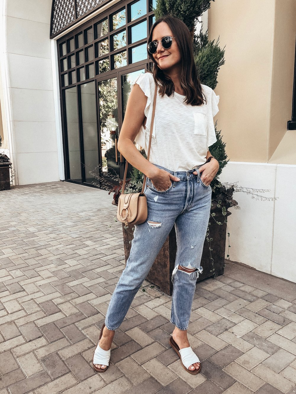 Outfit Details:  Free People Tee  |  Levi's Jeans  |  Bella Vita Slide Sandals  |  See by Chloe Bag  |  Ray-Ban Sunglasses  |  Madewell Circle Ring