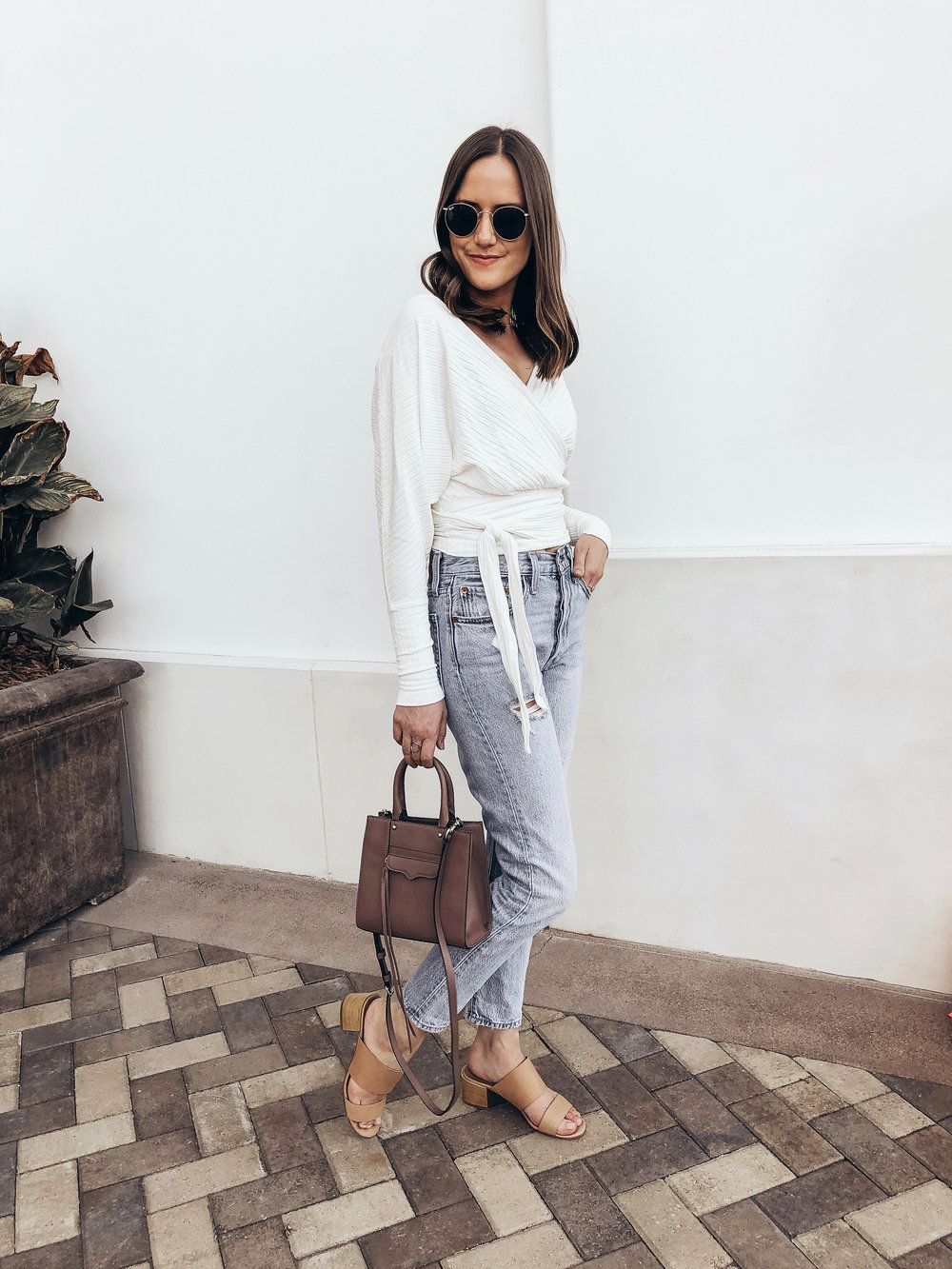 Shop the Look Below.  Free People Top  |  Levi's Jeans  |  Rebecca Minkoff Bag  |  Ray-Ban Sunglasses