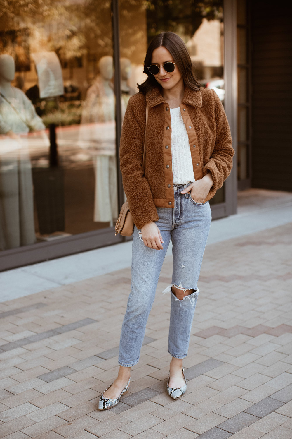 Shop the Look Below.  Anthropologie Sweater Tee  | Madewell Jacket  HERE  and  HERE  | Levi's Jeans  HERE ,  HERE  and HERE |  Shopbop Flats  |  See By Chloe Bag  |  Ray-Ban Sunglasses
