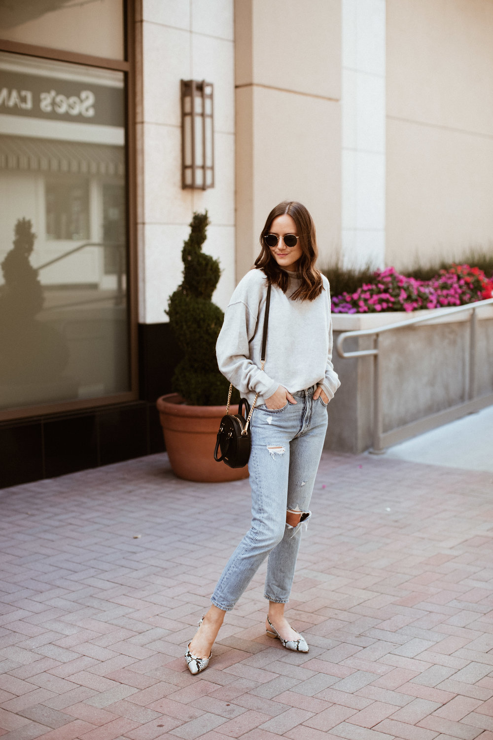 Shop the Look Below.  Free People Sweater  |  Levi's Jeans  |  Shopbop Flats  |  Rebecca Minkoff Bag  |  Ray-Ban Sunglasses