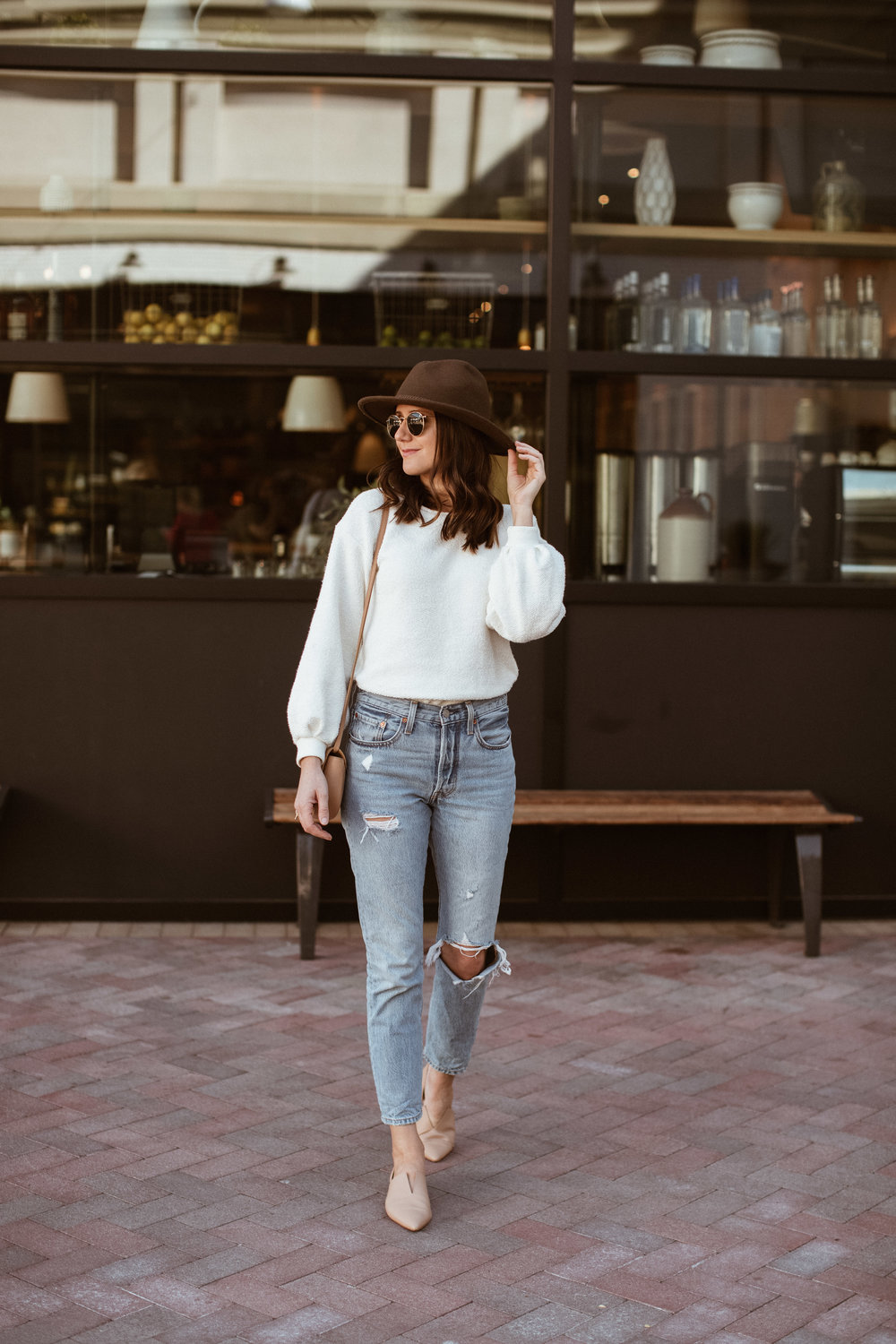 Shop the Look Below.  Anthropologie Sweatshirt  |  Levi's Jeans  |  Vince Flats  |  Treasure & Bond Hat  |  See By Chloe Bag  |  Ray-Ban Sunglasses