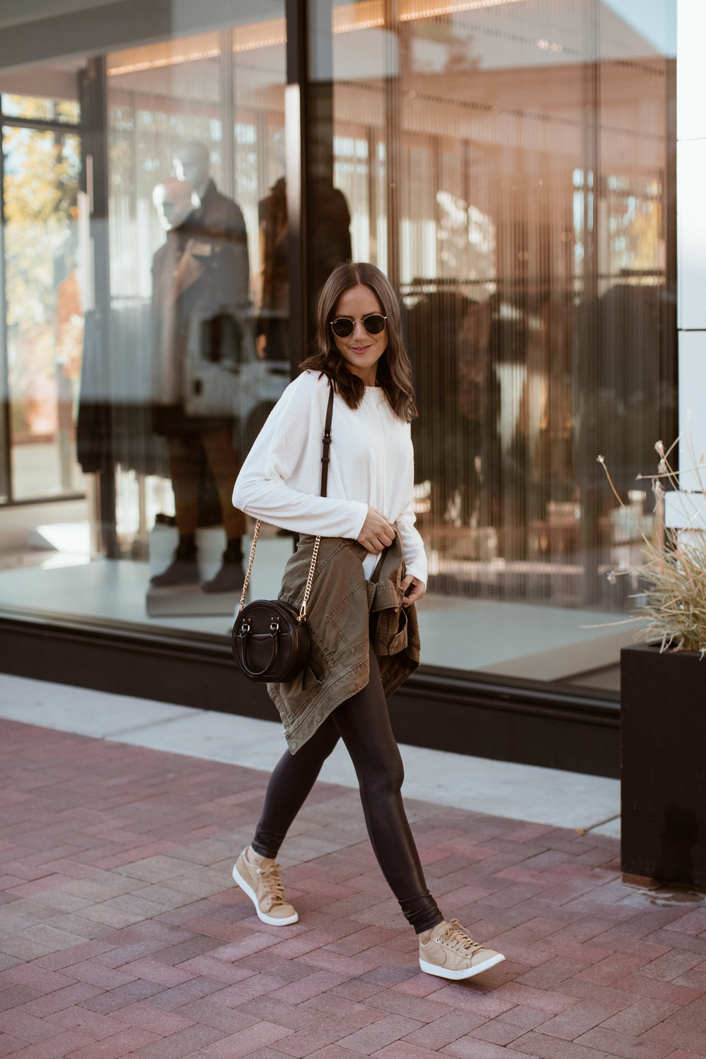 Shop the Look Below.  Nordstrom Rack Sweater  | Spanx Leggings  HERE  and  HERE  |  Nike Sneakers  |  Madewell Jacket  |  Rebecca Minkoff Bag  |  Ray-Ban Sunglasses