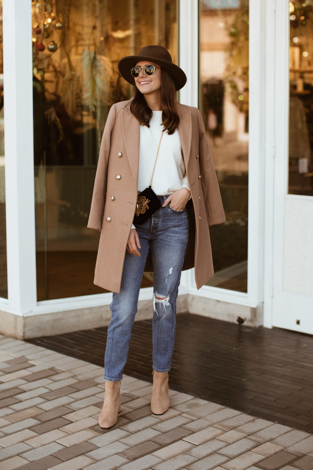 camel coat white sweater