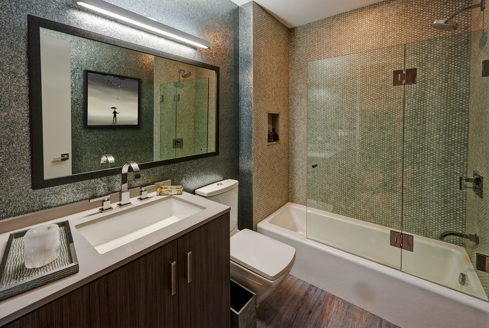 Fort Sheridan Ranch - Guest Bath   Metallic cork wallpaper. Penny round hand backed glass tiles on shower walls. Obeche wood vanity with chrome and leather handles.